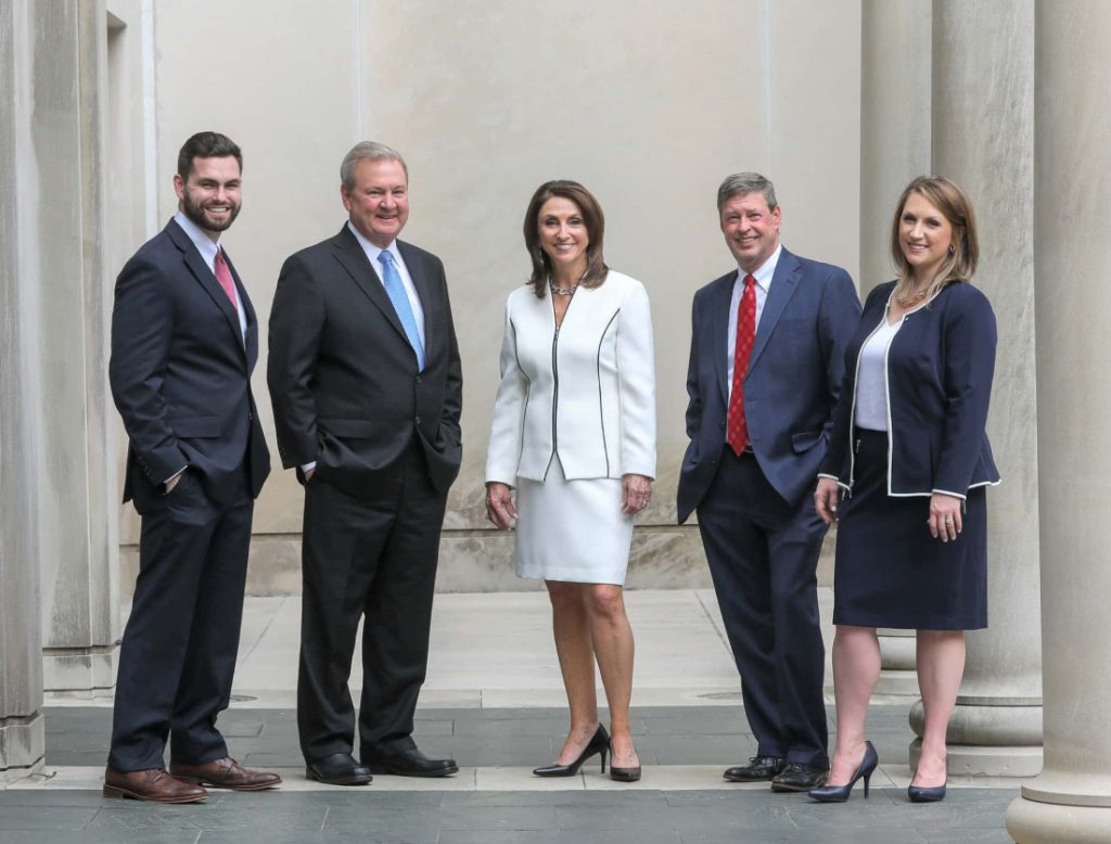 The Sewell Sewell Beard attorneys posing in outside an Alabama courthouse